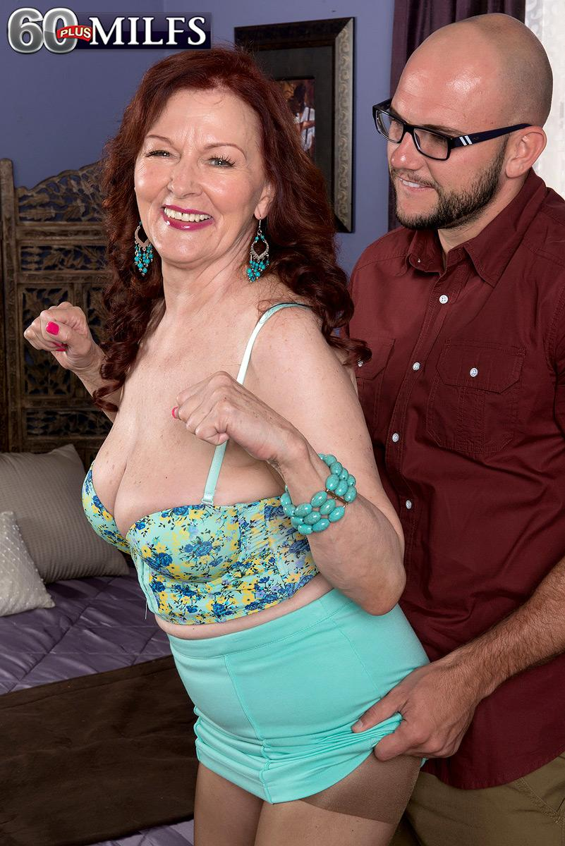 Chesty ginger-haired MILF over 60 Katherine Merlot giving gigantic dick tit-banging in nylons