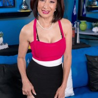 Chinese grandma Kim Anh is undressed down to lingerie before unsheathing humungous mature boobies