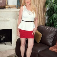 Elder light-haired dame Charlie has her immense melons unsheathed by younger stud in a crimson micro-skirt