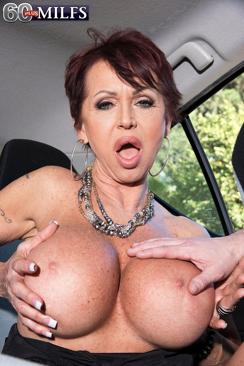 Elegant older broad Gina Milano entices a younger man with her massive boobies