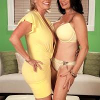 Experienced lesbos Lexi McCain and Rita Daniels having threesome sex in pumps
