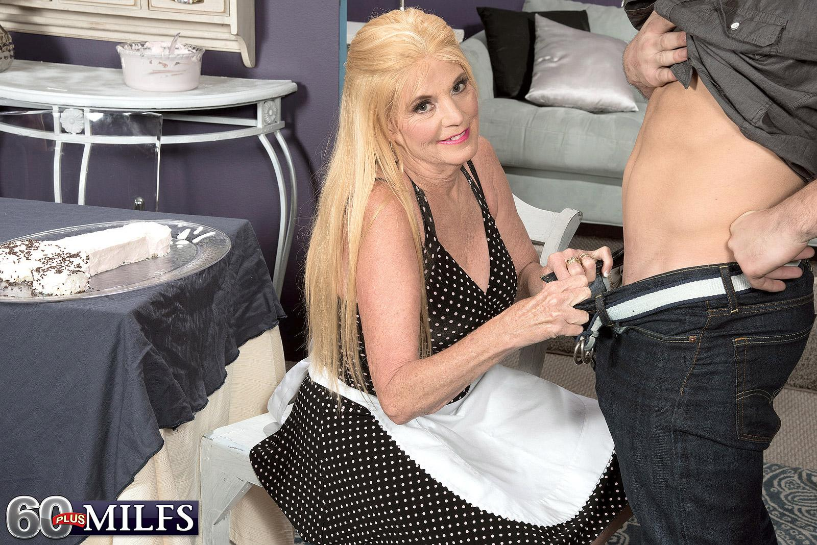 Fully clothed blond over sixty MILF Charlie providing CFNM hand job to giant dick
