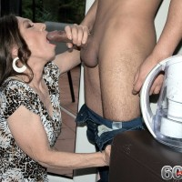 Fully-clothed granny Mona seducing younger man by giving his big cock blow-job