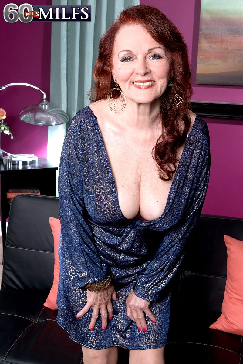 Ginger-haired grandmother Katherine Merlot exposing big all natural breasts to tempt sex