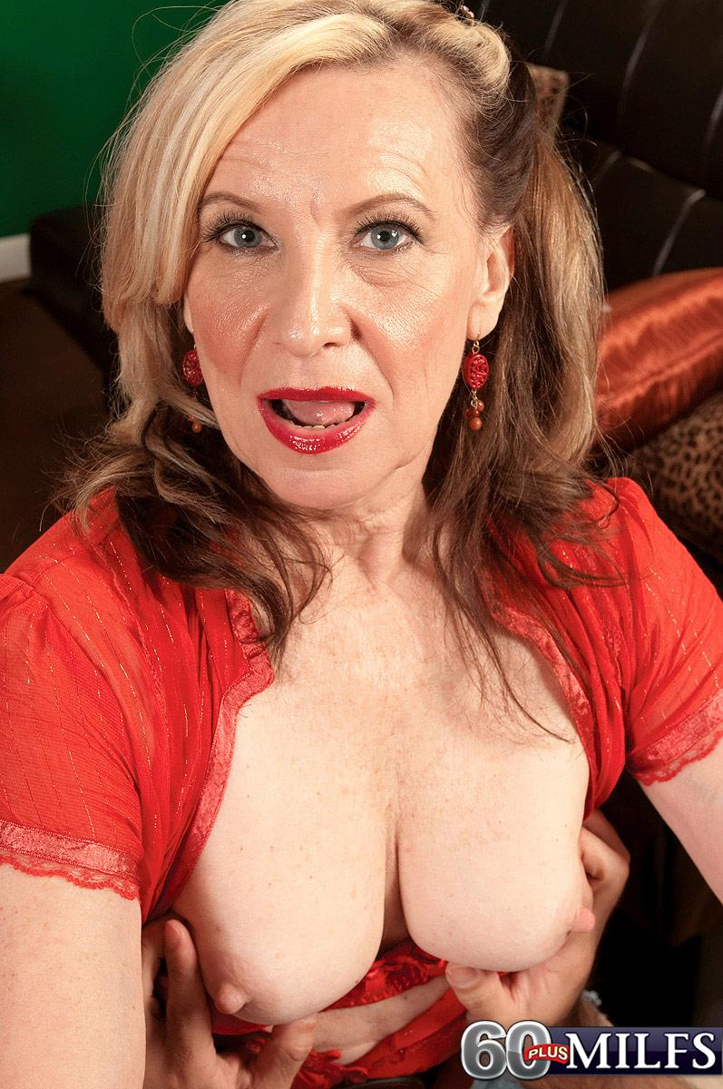 Golden-haired MILF over 60 Miranda Torri unsheathing large natural breasts and bare butt
