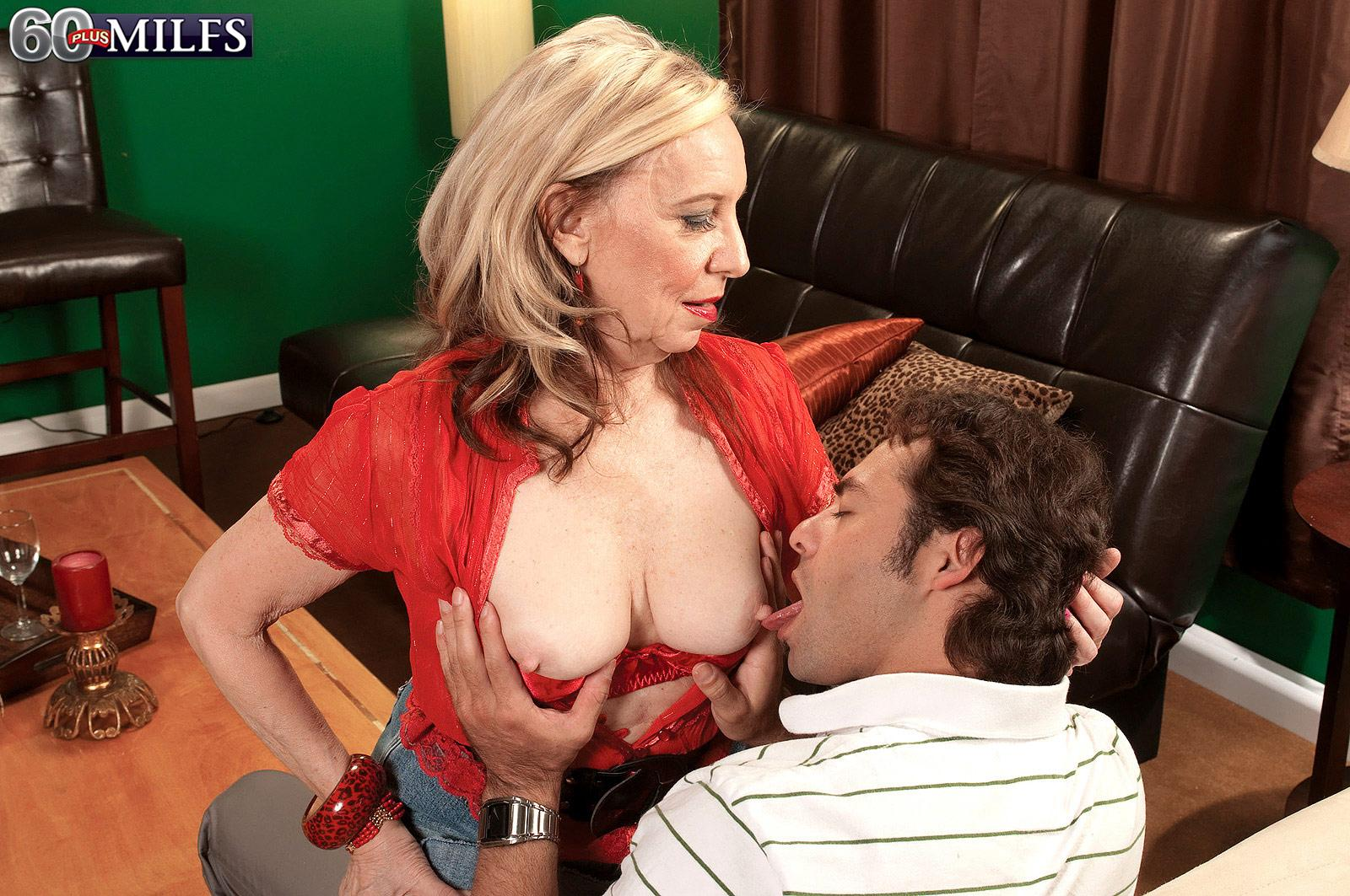 Golden-haired MILF over 60 Miranda Torri unsheathing large natural breasts and bare butt