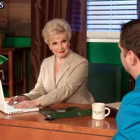 Grannie X-rated film starlet Jewel seducing sex from younger dude in office clad tan stockings