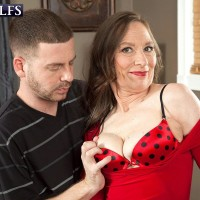 Hose and high heel wearing granny Mona readying for sex with younger stud