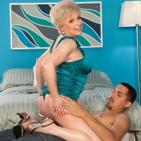 Huge-boobed grandmother Jewel having bare ass and slit ate by younger stud