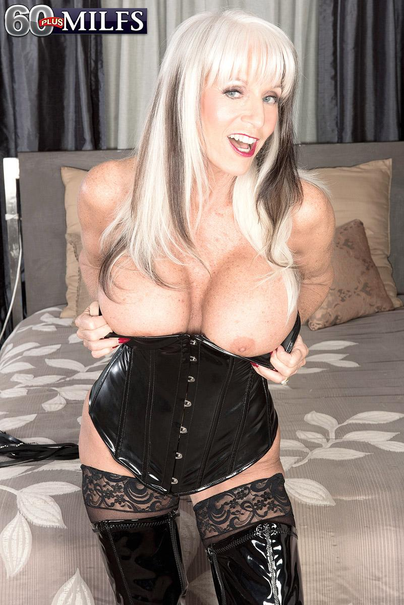 Huge titted 60 plus MILF Sally D'Angelo drains a pecker in latex boots and ebony corset