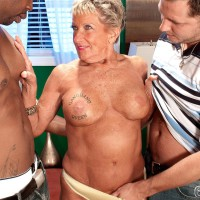 Huge-titted over 70 granny Sandra Ann stripped for bi-racial MMF 3some sex