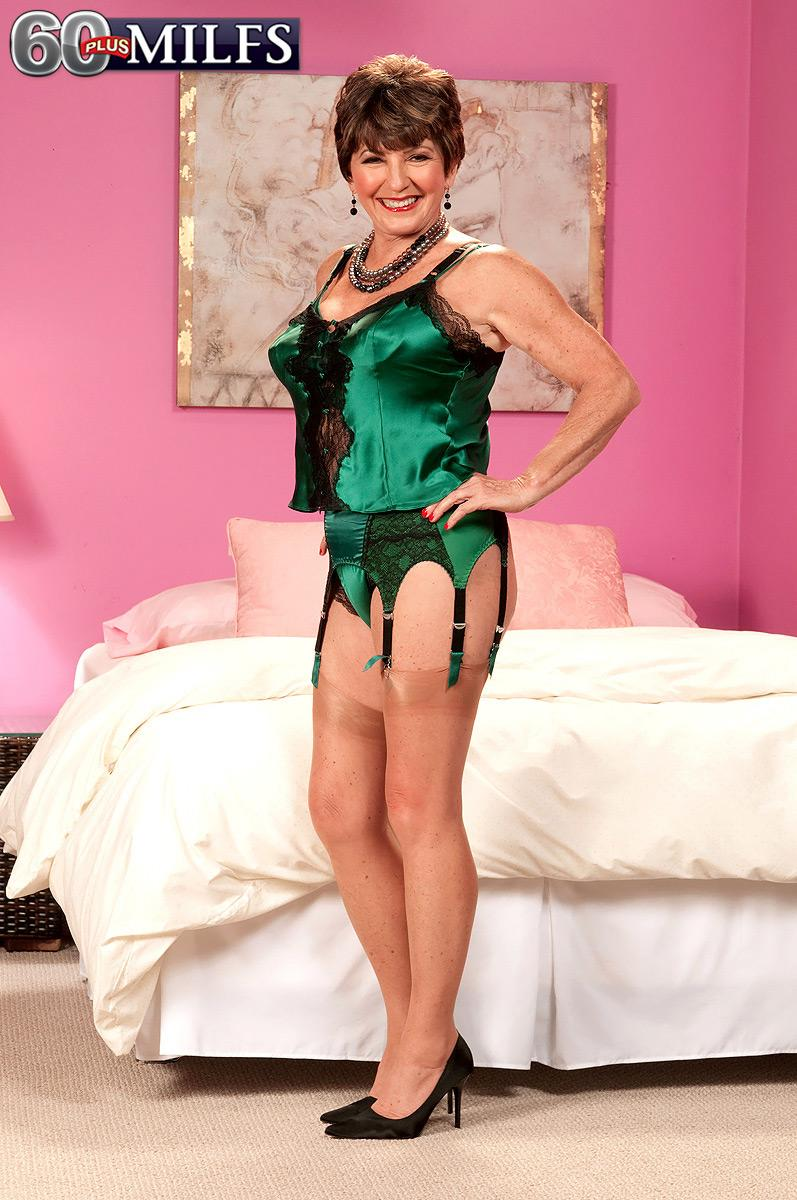 Lingerie and stocking adorned 60 plus MILF Bea Cummins loosing humungous experienced knockers