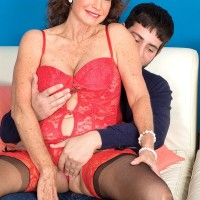 Lingerie attired brown-haired granny Jacqueline Jolie letting out massive hooters for nip licking