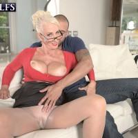 Mature blonde XXX star Madison Milstar freeing giant boobies and upskirt panties