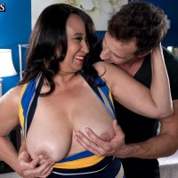 Old black-haired doll Rochelle Seductive uncovering gigantic all-natural juggs for nipple sucking