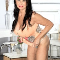 Over 60 brown-haired MILF Rita Daniels flashing amazing gams and hefty knockers