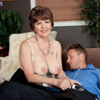 Over 60 MILF Bea Cummins letting hefty all natural boobies fall loose in micro-skirt and high-heeled shoes