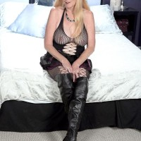 Over 60 platinum-blonde MILF uncovering immense all-natural boobies in ripped tights and lengthy boots
