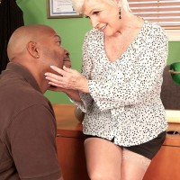 Over Sixty MILF letting out giant granny juggs before interracial sex in office with BIG BLACK DICK