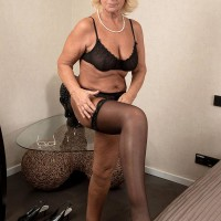 Platinum-blonde grandmother Regi letting floppy loose from bra before grease massage from masseur