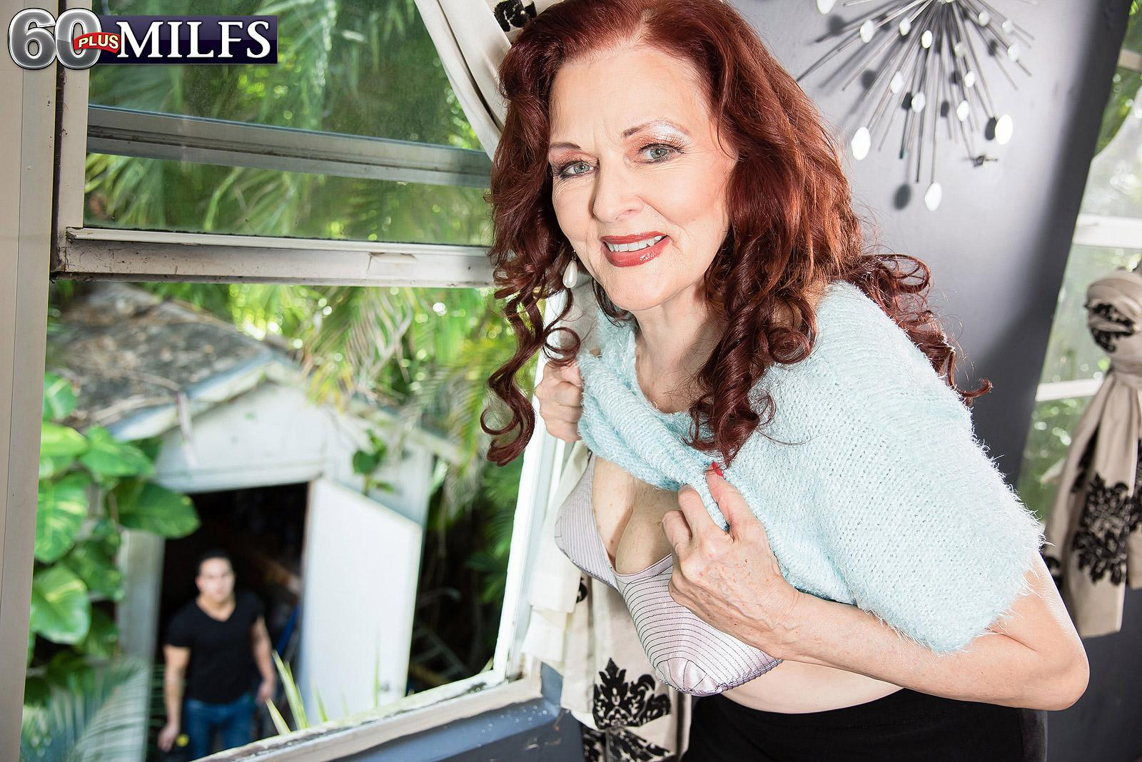 Red-haired MILF over 60 Katherine Merlot pulling out giant saggy titties for nipple play