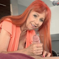 Redheaded granny with fine legs and humungous all natural fun bags delivering hand-job in kitchen