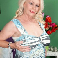 Round golden-haired MILF over 60 Angelique DuBois revealing pierced swell nips and giant tits