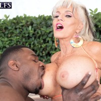 Sex grannie Sally D'Angelo and her big knockers take on a BIG BLACK COCK outdoors in a Jacuzzi
