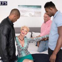 Gorgeous fair-haired grandma Seka Black sucks a couple of hefty ebony pricks during MMF sex