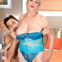 Short haired 60 plus MILF Lin Boyde freeing monster-sized titties from lingerie in hosiery