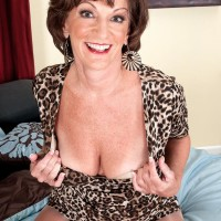 Solo grannie Sydni Lane teasing on bed by vaunting melon-holder in hose