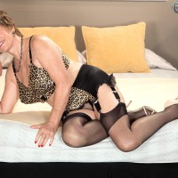 Stocking adorned granny Bea Cummins giving BIG BLACK DICK handjob in pumps and girdle
