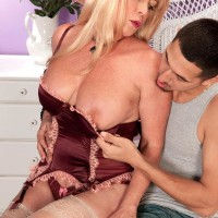 Stocking and lingerie clad 60 plus MILF Lexi McCain suggesting uber-cute arse for sex