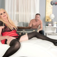 Stocking and lingerie garbed 60 plus blonde MILF Charlie letting out hefty boobs for nip play