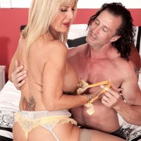 Stocking and lingerie outfitted mature adult movie star Phoenix Skye releasing massive melons and giving rubdown