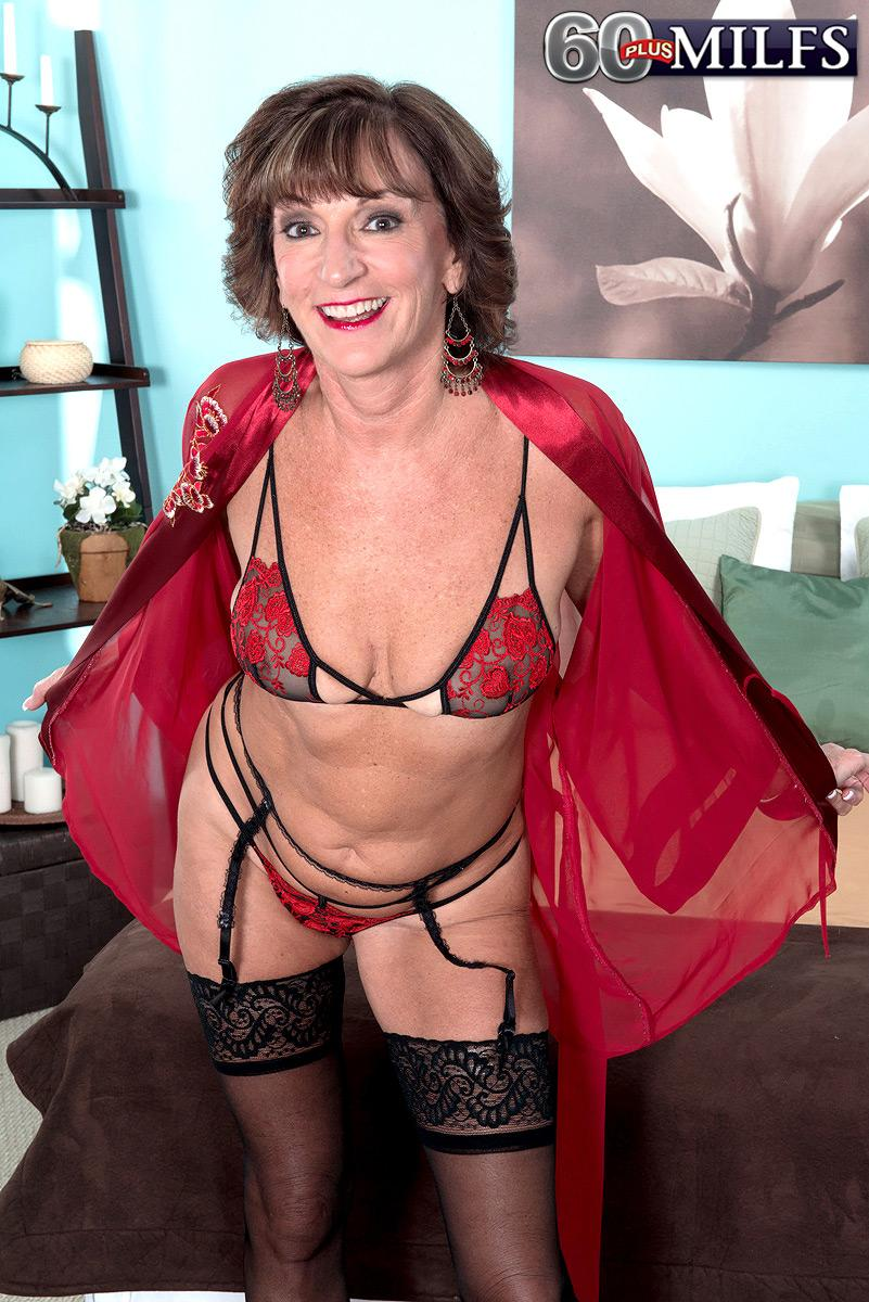 Stocking, garter and lingerie wearing 60 plus MILF Sydni Lane baring ass for sex acts