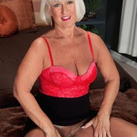 Stockings garmented mature lady Jeannie Lou showing off hefty butt before MMF threesome
