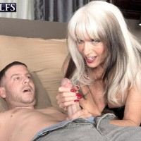 Stripper boot and spandex garbed older XXX actress Sally D'Angelo jacking and gobbling giant hard-on